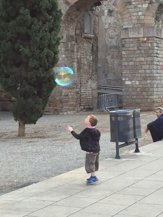 Boy and Bubble Outside the Cathedral in Barcelona