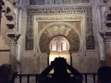 A young man photographs the niche in the spectacular Cordoba Mosque/Cathedral