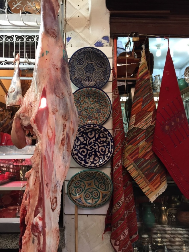 Meat, ceramics, and cloths for sale in Marrakech