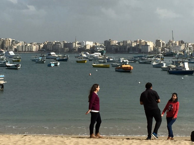 Beach view of Alexandria and some happy Egyptians
