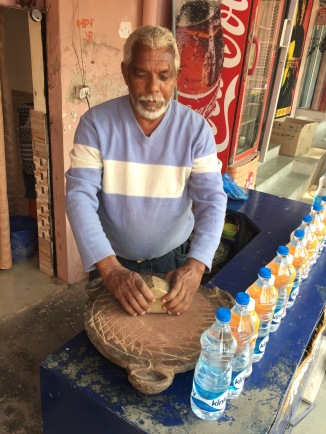 Mr. Thakur Grinding Thandai Herbs To Make Tea