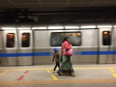 Mother And Child In Delhi Subway