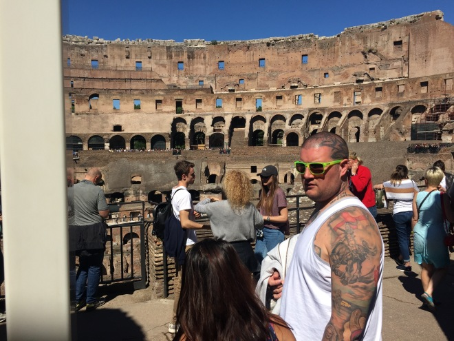 big man with tattoos, Colosseum