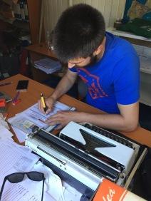 Clerk sells us Bosnia Road Insurance with Manual Typewriter